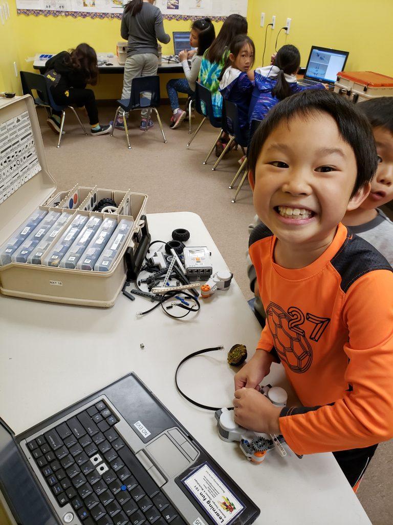 Happy student LEGO Robotics Programming